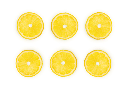Yellow lemon slices isolated on white background, top view. Lemon citrus vitamin c concept, summer bright composition. Banque d'images