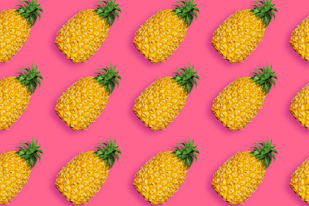 Pineapple pattern, conceptual image. Ripe tropical fruit on vivid pink background, summertime minimalist concept.