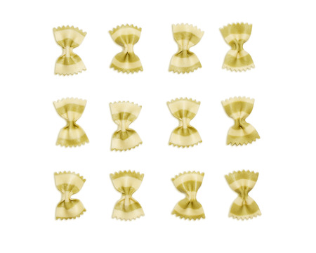 Bow tie Italian pasta fartalle isolated on white background, top view. Dry uncooked macaroni concept.