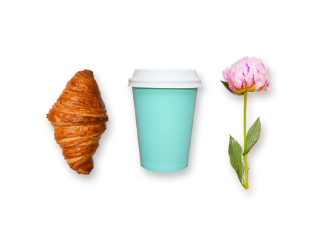 Fresh croissant, coffee take away and pink peony flower on white background, top view. Minimalistic flat lay concept of womans breakfast dessert.