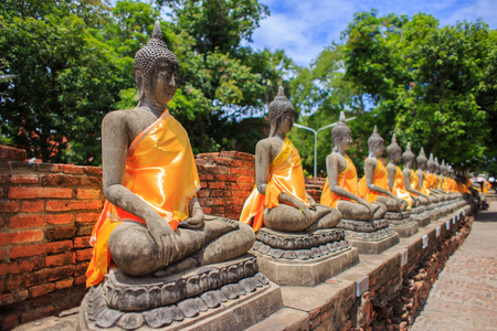 pay wall: Buddha meditating on the base and walls of old Stock Photo