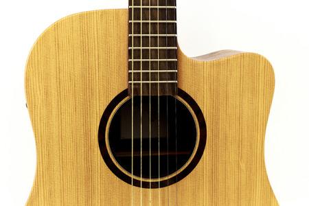 medium body: Medium body guitar with six strings on a white background.