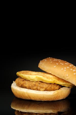 luscious: The hamburger and reflection on black background.