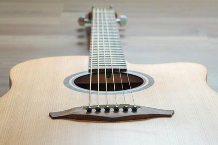 Medium body guitar on wood floor