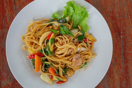 odorous: Top view of spaghetti with pork on the wood table.