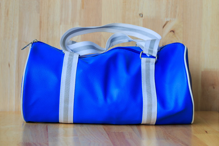 topicality: Blue bag on wood background.