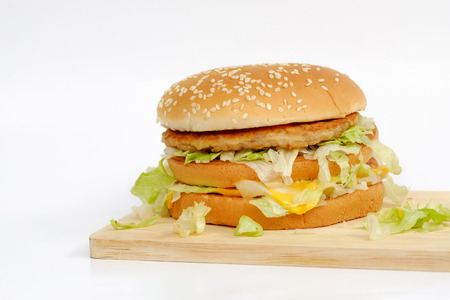 Pork and cheese hamburger on wood and on white background.