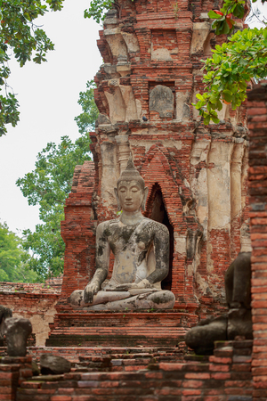 Buddha meditating on the base in the old temple.