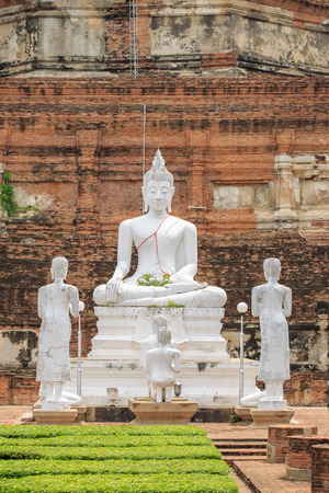 an obeisance: White Buddha meditating on the base in the old temple.