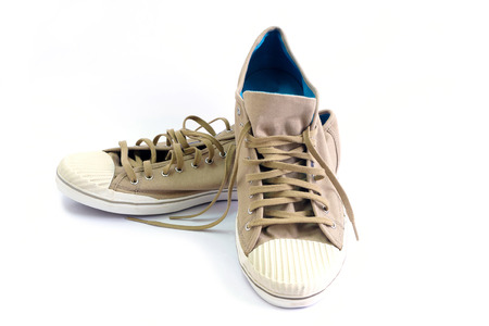 Brown canvas shoes on white background. Stock Photo