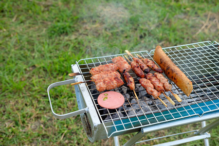 Food grilling on the barbecue grills on the garden. Stock Photo