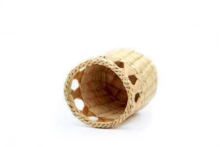 comprise: A wicker basket on white background. Stock Photo