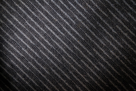 slantwise: Abstract background from pattern diagonal of gray carpet in somewhere light and shadow.