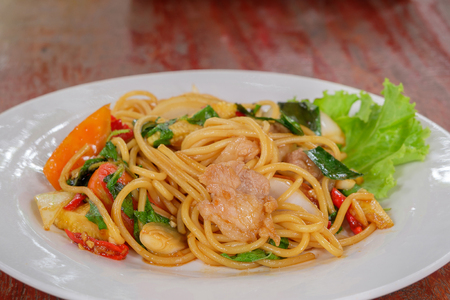 The spaghetti with pork on the wood table. Stock Photo
