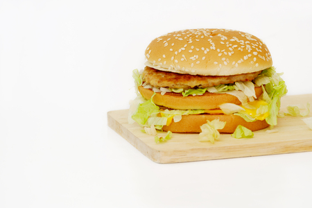 odorous: Pork and cheese hamburger on wood and on white background.