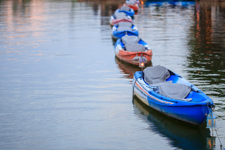 downstream: The row of boats in the river.