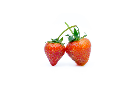The red strawberries on white background.