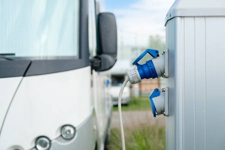 Camping caravan charge electric power for use in car.
