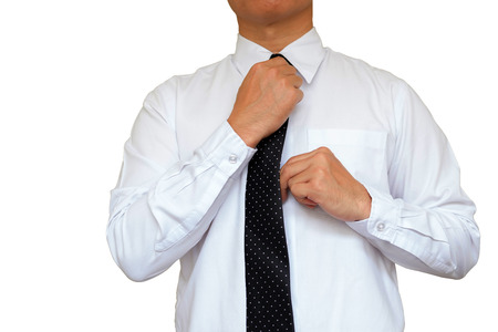 Businessman set his necktie on white background. Stock Photo