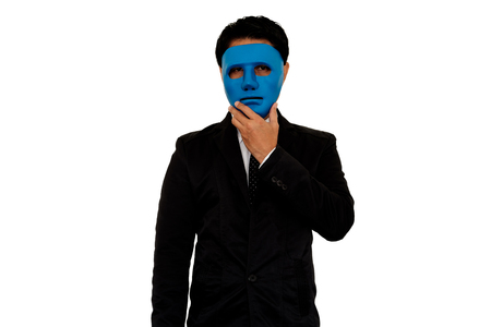 Businessman wearing blue mask on white background. Stock Photo
