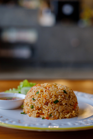 Closeup spicy fried rice in white plate. Stock Photo