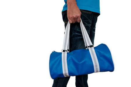 Man in casual wear holding blue bag on white background.