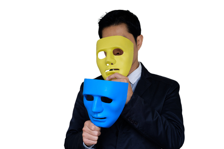 Concept of businessman changing mask. Man have two mask in hand on white background with clipping path.