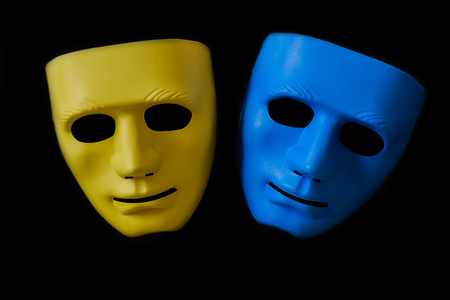 Yellow and blue mask on black background. Stock Photo