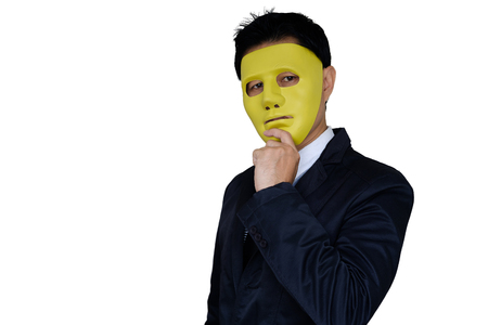 Businessman wear yellow mask on white background with clipping path.