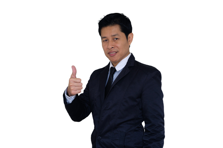 Handsome businessman in suit smiles and lifts his hand make the superb sign on white background with clipping path.