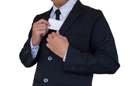 Businessman in black suit picking pasteboard out of pocket on white background Stock Photo