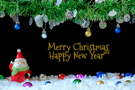 Decorations with ornaments and Santa clause doll for Christmas day on black background with copy space. 스톡 콘텐츠