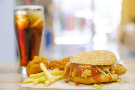 Chicken hamburger and fried chicken with cola on warm light. 版權商用圖片