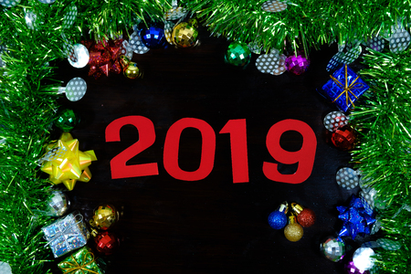 Decorations background with ornaments for new year 2019 on wooden.