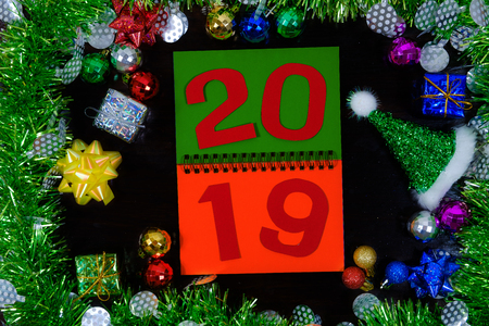 2019 on paper note in decorations background with ornaments for new year.