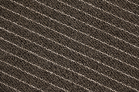 Abstract background from pattern diagonal of gray carpet.