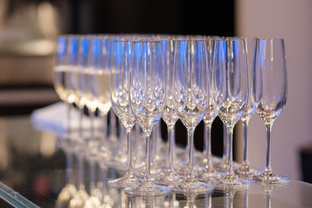 Many empty glass on the bar ready to fill wine.
