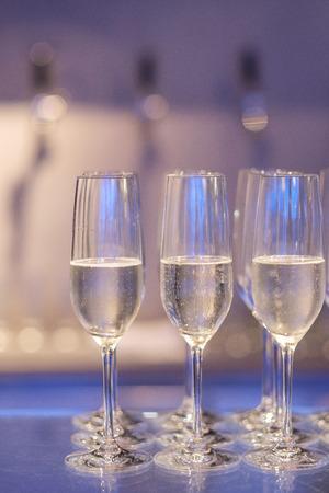 White wine in glass on bar ready to drink. 版權商用圖片