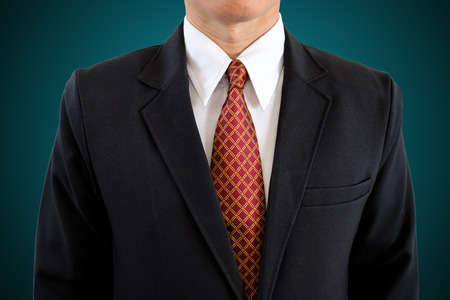 Handsome businessman in black suit on isolated background with clipping path.