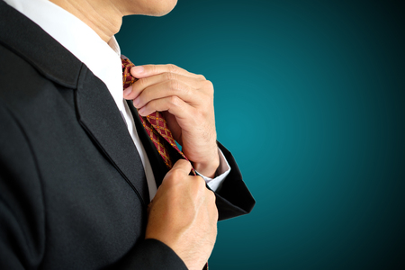 Businessman set his necktie on isolated background with clipping path.