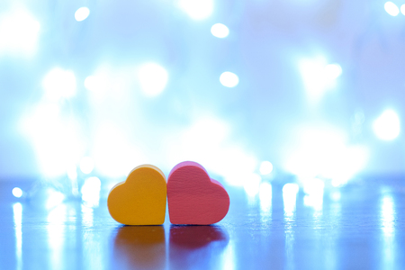 Little two hearts on light background with copy space.