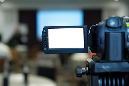 Closeup video camera recording in seminar room. 版權商用圖片