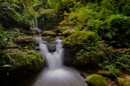 The beautiful waterfall in the forest in Thailand. Long exposure. Waterfall photography background.