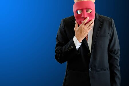 The man hold red mask in hand on blue background
