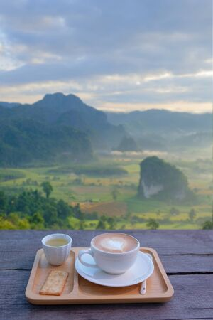 Read to drink hot coffee and look beautiful view in morning.   版權商用圖片