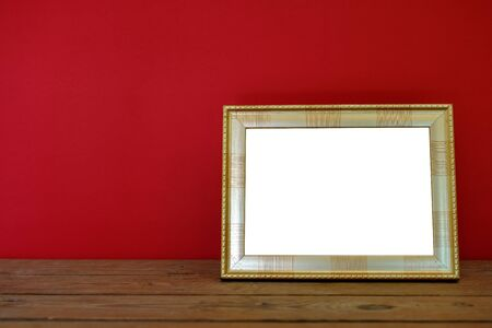 Picture frame on wooden on red 版權商用圖片