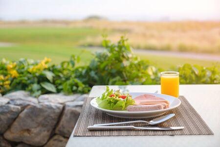 Breakfast on the table in morning on warm light. 版權商用圖片