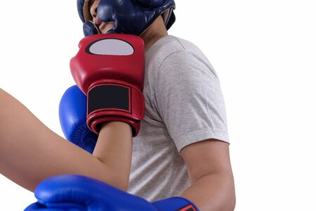Red mitt boxer is punching to head the blue mitt boxer on white background with clipping path.