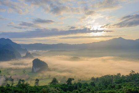 Beautiful sunrise on mountain which the mist cover all area at Phayao province, Thailand