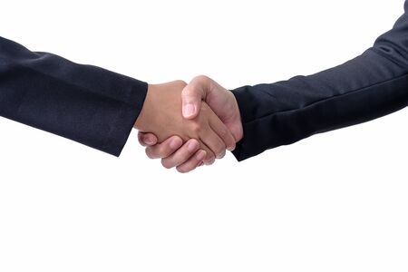 Two businessmen shake hands on white background with clipping path.